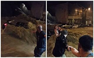 美东暴雨引发洪水 市民拉手救激流中妇女