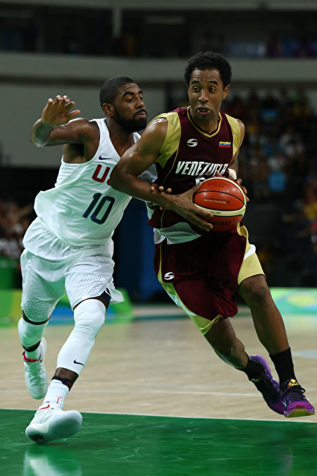 RIO DE JANEIRO, BRAZIL - AUGUST 08: Jhon Cox #6 of Venezuela shoots the ball over Demarcus Cousins #12 of United States in the men's preliminary round group A game 19 on Day 3 of the Rio 2016 Olympic Games at the Carioca Arena 1 on August 8, 2016 in Rio de Janeiro, Brazil. (Photo by Bryn Lennon/Getty Images)