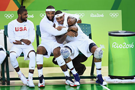 RIO DE JANEIRO, BRAZIL - AUGUST 08: Kyrie Irving #10, Demarcus Cousins #12 and Carmelo Anthony #15 of United States joke around on the bench during the Men's Preliminary Round between the United States and Venezuela on Day 3 of the Rio 2016 Olympic Games at the Carioca Arena 1 on August 8, 2016 in Rio de Janeiro, Brazil. (Photo by David Ramos/Getty Images)
