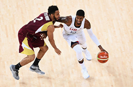 RIO DE JANEIRO, BRAZIL - AUGUST 08: Paul George #13 of United States handles the ball against Dwight Lewis #2 of Venezuela during the Men's Preliminary Round between the United States and Venezuela on Day 3 of the Rio 2016 Olympic Games at the Carioca Arena 1 on August 8, 2016 in Rio de Janeiro, Brazil. (Photo by David Ramos/Getty Images)