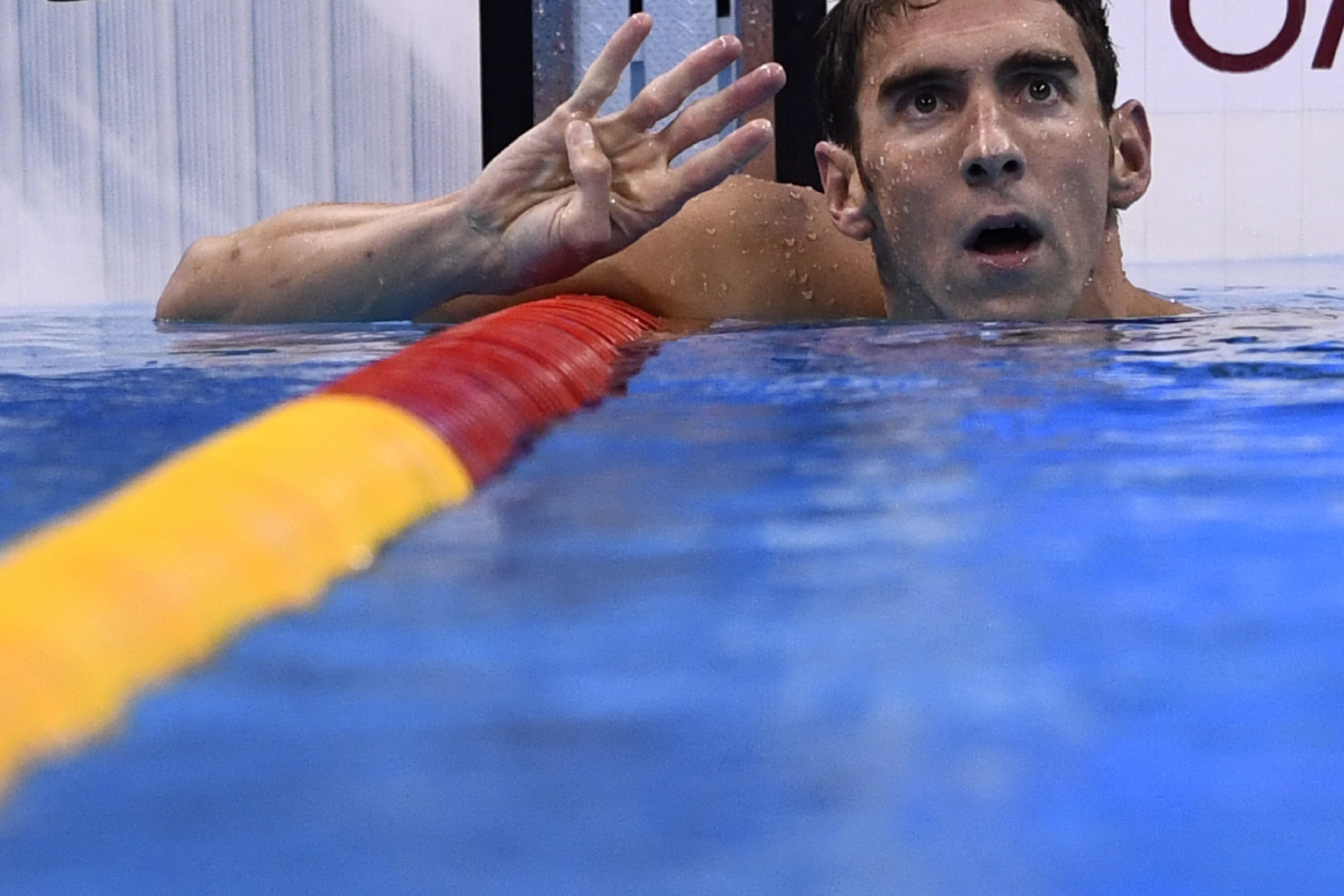 菲比斯在男子200米個人混合泳,贏得今屆奧運第4金 ,將奧運金牌數增加到22枚,並實現這個項目上的奧運四連冠。(CHRISTOPHE SIMON/AFP/Getty Images)