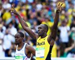 男子百米大戰14日晚登場,衛冕冠軍牙買加「閃電」博爾特揚言要實現史無前例的奧運會100米、200米和4x100米接力三項三連冠。(Ian Walton/Getty Images)