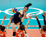 RIO DE JANEIRO, BRAZIL - AUGUST 18:  Ting Zhu of China strikes the ball at the Netherlands defence during the Women's Volleyball Semifinal match at the Maracanazinho on Day 13 of the 2016 Rio Olympic Games on August 18, 2016 in Rio de Janeiro, Brazil.  (Photo by Jamie Squire/Getty Images)