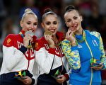 (From L) Silver medallist Russia's Yana Kudryavtseva, gold medallist Russia's Margarita Mamun and bronze medallist Ukraine's Ganna Rizatdinova pose on the podium of the individual all-around final event of the Rhythmic Gymnastics at the Olympic Arena during the Rio 2016 Olympic Games in Rio de Janeiro on August 20, 2016. / AFP / Thomas COEX        (Photo credit should read THOMAS COEX/AFP/Getty Images)