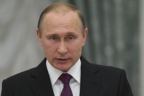 俄羅斯18日舉行國會下議院(國家杜馬)選舉,出口民調顯示,普京陣營明顯獲勝。(PAVEL GOLOVKIN/AFP/Getty Images)