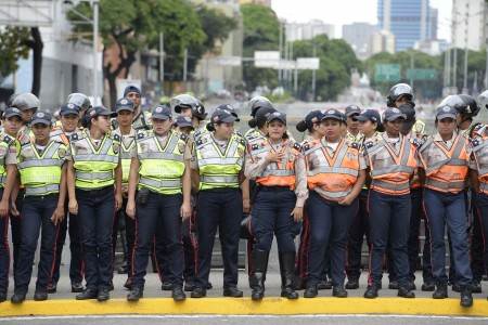 Venezuelan police face demonstrators before an opposition march in Caracas, on September 1, 2016. Venezuela's opposition and government head into a crucial test of strength Thursday with massive marches for and against a referendum to recall President Nicolas Maduro that have raised fears of a violent confrontation. / AFP / FEDERICO PARRA (Photo credit should read FEDERICO PARRA/AFP/Getty Images)