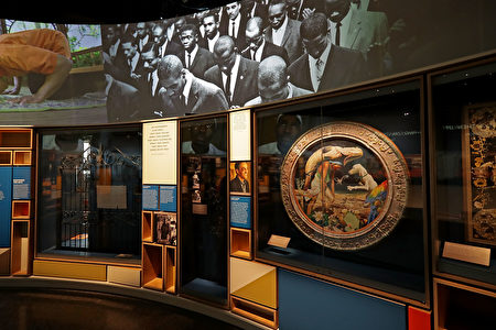 WASHINGTON, DC - SEPTEMBER 14: A mix of video screens, printed information, sculpture and other artifacts fill the first space the fourth floor's Culture Galleries at the Smithsonian's National Museum of African American History and Culture on the National Mall September 14, 2016 in Washington, DC. Filled with exhibits and artifacts telling the story of the first Africans in the United States and their descendents, the 400,000-square-foot museum will open to the public on September 24. (Photo by Chip Somodevilla/Getty Images)