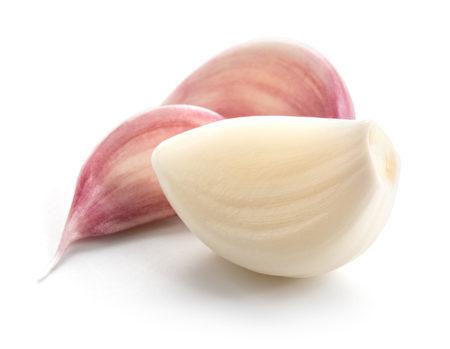 Garlic cloves isolated on white background.(shutterstock)