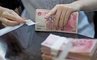 六年新低 人民幣中間價跌破6.7