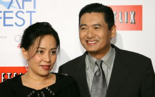 "HOLLYWOOD - NOVEMBER 12:  Actor Chow Yun Fat and wife Jasmine Chow arrive for the closing night gala presentation of the film ""Curse of the Golden Flower"" during AFI FEST 2006 presented by Audi held at Arclight Theatre on November 12, 2006 in Hollywood, California.  (Photo by Michael Buckner/Getty Images)"