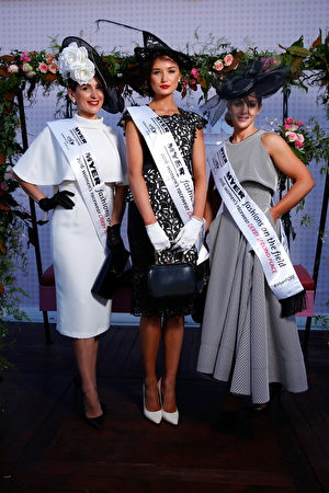 MELBOURNE, AUSTRALIA - OCTOBER 29: Myer Fashions on the Field Women's Racewear competition winner Gunita Kenina (C) and Runners Up Stacey Hanley and Tanya Lazarou pose in the Myer Fashion On The Field Marquee on Victoria Derby Day at Flemington Racecourse on October 29, 2016 in Melbourne, Australia. (Photo by Daniel Pockett/Getty Images for the VRC)