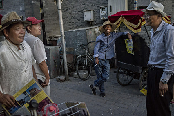 北京方言在消失。它是語言標準化、城市發展和移民的犧牲品。(Kevin Frayer/Getty Images)