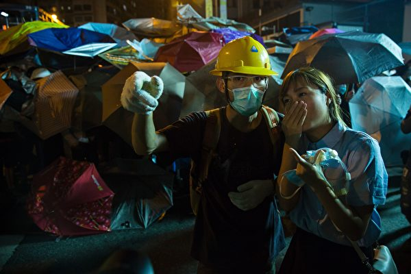 Yau Wai-ching (R) of the Youngspirations organisation speaks with a protester (L) amid ongoing demonstrations in Hong Kong on November 6, 2016. Hong Kong police used pepper spray November 6 to drive back hundreds of protesters angry at China's decision to intervene in a row over whether two pro-independence lawmakers should be barred from the city's legislature. In chaotic scenes reminiscent of mass pro-democracy protests in 2014, demonstrators charged metal fences set up by police outside China's liaison office in the semi-autonomous city. / AFP / ISAAC LAWRENCE (Photo credit should read ISAAC LAWRENCE/AFP/Getty Images)