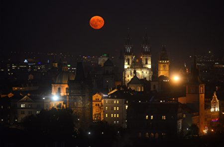 The supermoon rises above the Old Town square, on November 14, 2016 in Prague. The unusually big and bright moon appeared at its most impressive as night fell over Asia, but astronomy enthusiasts will be able to see Earth's satellite loom large anywhere in the world shortly after sunset. / AFP / Michal Cizek (Photo credit should read MICHAL CIZEK/AFP/Getty Images)