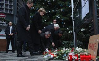组图:柏林卡车恐袭后 鲜花蜡烛寄哀思