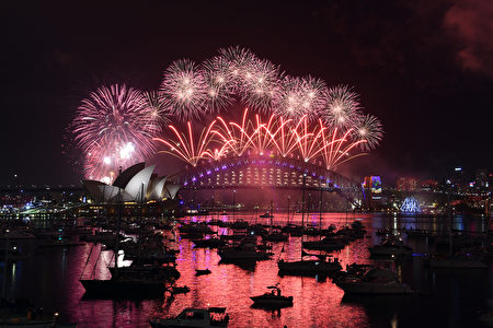 New Year fireworks illuminate the sky over the iconic Opera House and Harbour Bridge in Sydney on January 1, 2017. / AFP / SAEED KHAN (Photo credit should read SAEED KHAN/AFP/Getty Images)