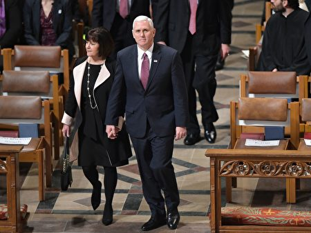 US Vice President Mike Pence and Karen Pence aarive for the National Prayer Service at the National Cathedral on January 21, 2017, in Washington, DC. / AFP / Mandel NGAN (Photo credit should read MANDEL NGAN/AFP/Getty Images)