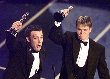 "LOS ANGELES, UNITED STATES: Ben Affleck (L) and Matt Damon hold up their Oscars after winning in the Original Screenplay Category during the 70th Academy Awards at the Shrine Auditorium 23 March. The two won for their Original Screenplay ""Good Will Hunting."" (ELECTRONIC IMAGE) AFP PHOTO/Timothy A. Clary (Photo credit should read TIMOTHY A. CLARY/AFP/Getty Images)"