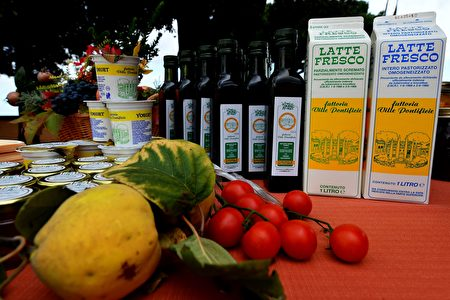 A photo taken on October 21, 2016 shows produce, yogurt, milk and olive oil from the organic farm at Pontiff's private apartments, now open to tourists as a museum, at the former summer residence in Castel Gandolfo. Pope Francis has renounced the delights of Castel Gandolfo outside Rome and opened his private apartments to tourists, the Vatican said on October 21. Pope Francis has visited the palace 25 kilometres (15 miles) from Rome only a couple of times since his election in 2013, and has never spent the night there. Francis opened the estate's gardens to the public in 2014, since last year tourists have also been able to climb aboard a special white train for an express trip to the lavish estate and a tour of the papal villa, including the past pope's organic farm, which houses cows, free-range hens, cockerels and pontifical bees. / AFP / ALBERTO PIZZOLI (Photo credit should read ALBERTO PIZZOLI/AFP/Getty Images)