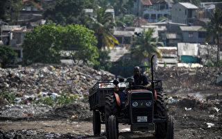 斯里蘭卡垃圾場失火 數十棚屋遭掩埋