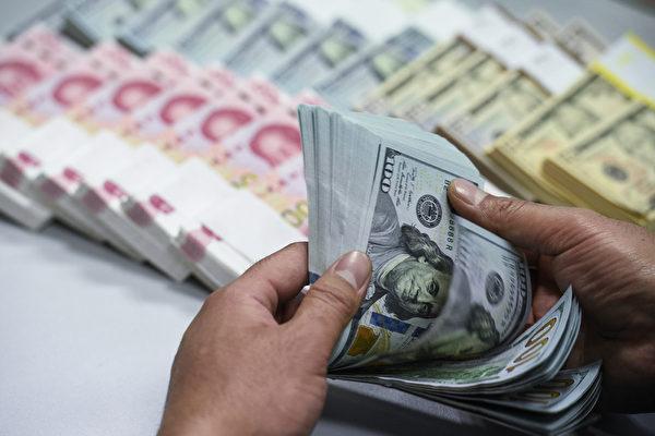 7月24日,中共當局再次發動刺激引擎,但是人民幣卻應聲下跌。(大紀元資料室)_