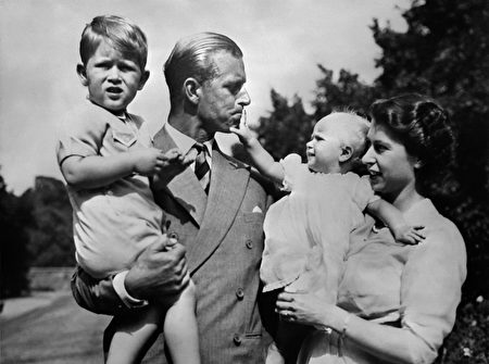 Undated picture showing the Royal British couple, Queen Elizabeth II, and her husband Philip, Duke of Edinburgh, with their two children, Charles, Prince of Wales (L) and Princess Anne (R), circa 1951. (Photo credit should read OFF/AFP/Getty Images)
