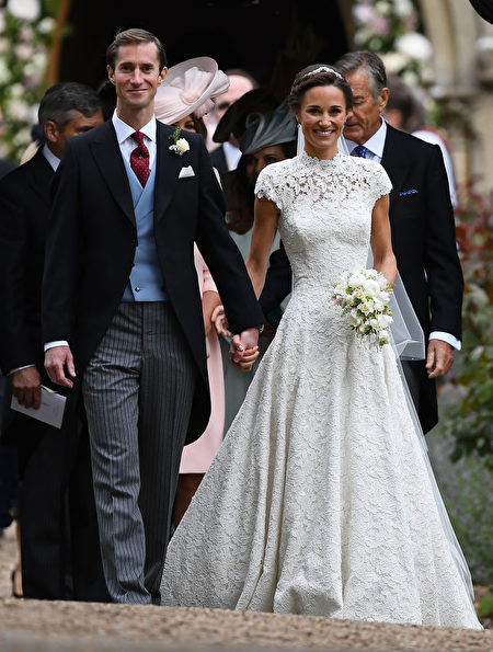ENGLEFIELD GREEN, ENGLAND - MAY 20: Pippa Middleton and her new husband James Matthews leave church following their wedding ceremony at St Mark's Church as the bridesmaids and pageboys walk ahead on May 20, 2017 in Englefield Green, England. (Photo by Justin Tallis - WPA Pool/Getty Images)