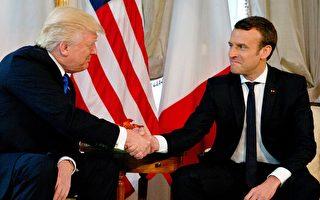 法國新總統馬克龍的握手,似乎讓川普有點招架不住。(PETER DEJONG/AFP/Getty Images)