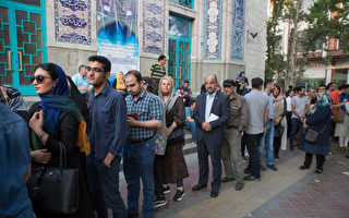 伊朗总统大选初步结果 鲁哈尼赢得连任