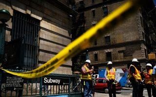 铁轨违规堆在轨道上致火车脱轨 MTA两高管被停职