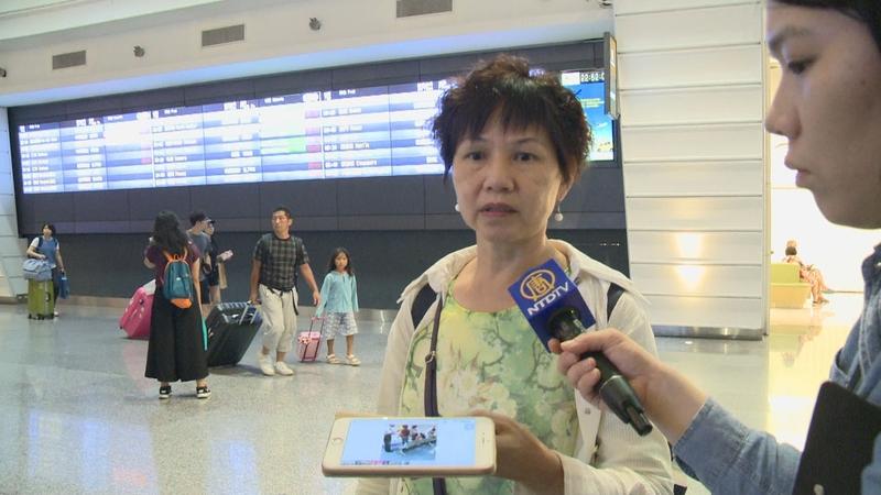 遭港府非法遣返的台灣法輪功學員徐女士說,從早上10點多抵達香港,到晚間7點才被遣返,沒有告訴他們任何理由。(新唐人電視)