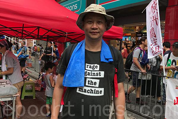 资深媒体人刘细良呼吁港人七一站出来,捍卫香港的一国两制,同时提醒港人要非常谨慎和小心,不要爆发暴力冲突。(王文君/大纪元)