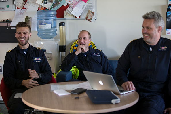 CAMBRIDGE, ENGLAND - JULY 27: Prince William, Duke of Cambridge (C) is seen in the briefing room with the crew as starts his final shift with the East Anglian Air Ambulance based out of Marshall Airport on July 27, 2017 near Cambridge, England. (Photo by Heathcliff O'Malley - WPA Pool/Getty Images)