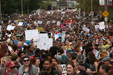 BOSTON, MA - AUGUST 19: Thousands of protesters prepare to march in Boston against a planned 'Free Speech Rally' just one week after the violent 'Unite the Right' rally in Virginia left one woman dead and dozens more injured on August 19, 2017 in Boston, United States. Although the rally organizers stress that they are not associated with any alt-right or white supremacist groups, the city of Boston and Police Commissioner William Evans are preparing for possible confrontations at the afternoon rally. (Photo by Spencer Platt/Getty Images)