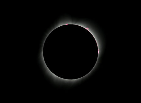 Red prominences coming off the sun are seen during a total solar eclipse from the Lowell Observatory Solar Eclipse Experience on August 21, 2017 in Madras, Oregon. Emotional sky-gazers on the US West Coast cheered and applauded Monday as the Sun briefly vanished behind the Moon -- a rare total solar eclipse that will stretch across North America for the first time in nearly a century. / AFP PHOTO / STAN HONDA (Photo credit should read STAN HONDA/AFP/Getty Images)