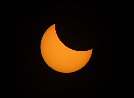 A crescent sun is viewed during a solar eclipse seen from the Lowell Observatory Solar Eclipse Experience on August 21, 2017 in Madras, Oregon. Emotional sky-gazers on the US West Coast cheered and applauded Monday as the Sun briefly vanished behind the Moon -- a rare total solar eclipse that will stretch across North America for the first time in nearly a century. / AFP PHOTO / STAN HONDA (Photo credit should read STAN HONDA/AFP/Getty Images)