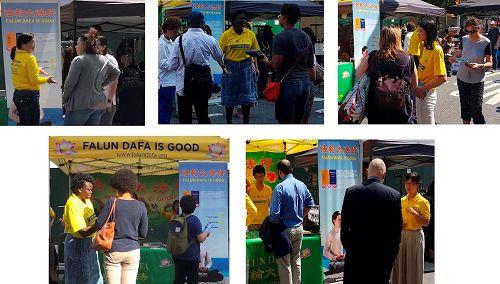 街市上人们纷纷驻足听学员们介绍法轮功(明慧网)