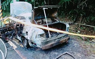 路边修车遭引擎盖掉下夹住  车主被烧死