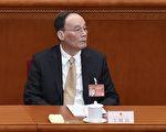 中共十九大前,中纪委书记王岐山是否留任,成为各方揣测的热点。 (WANG ZHAO/AFP/Getty Images)