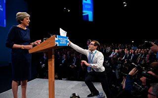 英国保守党大会内斗阴影笼罩 首相居中维和