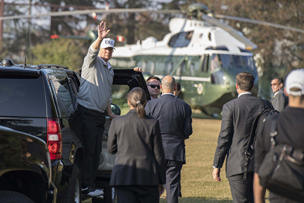 US President Donald Trump (L) waves as he exits his vehicle after playing a round of golf with Japanese Prime Minister Shinzo Abe at the Kasumigaseki Country Club Golf Course in Kawagoe, Saitama prefecture, outside Tokyo on November 5, 2017. Trump touched down in Japan on November 5, kicking off the first leg of a high-stakes Asia tour set to be dominated by soaring tensions with nuclear-armed North Korea. / AFP PHOTO / JIM WATSON (Photo credit should read JIM WATSON/AFP/Getty Images)