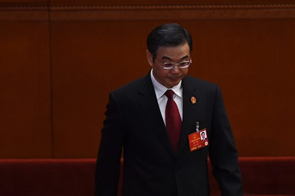 Zhou Qiang, President of the Supreme People's Court, is applauded as he walks out to deliver his work report during the third plenary session of the National People's Congress in the Great Hall of the People in Beijing on March 13, 2016. China found almost 100 percent of criminal defendants guilty last year, figures from the country's top court showed on March 13, even as authorities pledged to reduce wrongful convictions. / AFP / GREG BAKER (Photo credit should read GREG BAKER/AFP/Getty Images)