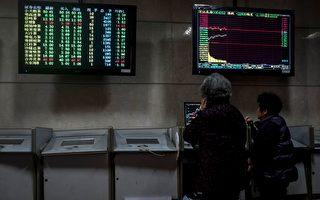 3月23日,大陆股市、商品、汇市下跌,其中沪指暴跌3.39%。(OHANNES EISELE/AFP/Getty Images)