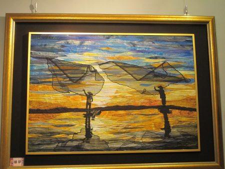 來自北港的周秀惠的作品「捕夢」呈現台西人的撒網捕魚的生活。