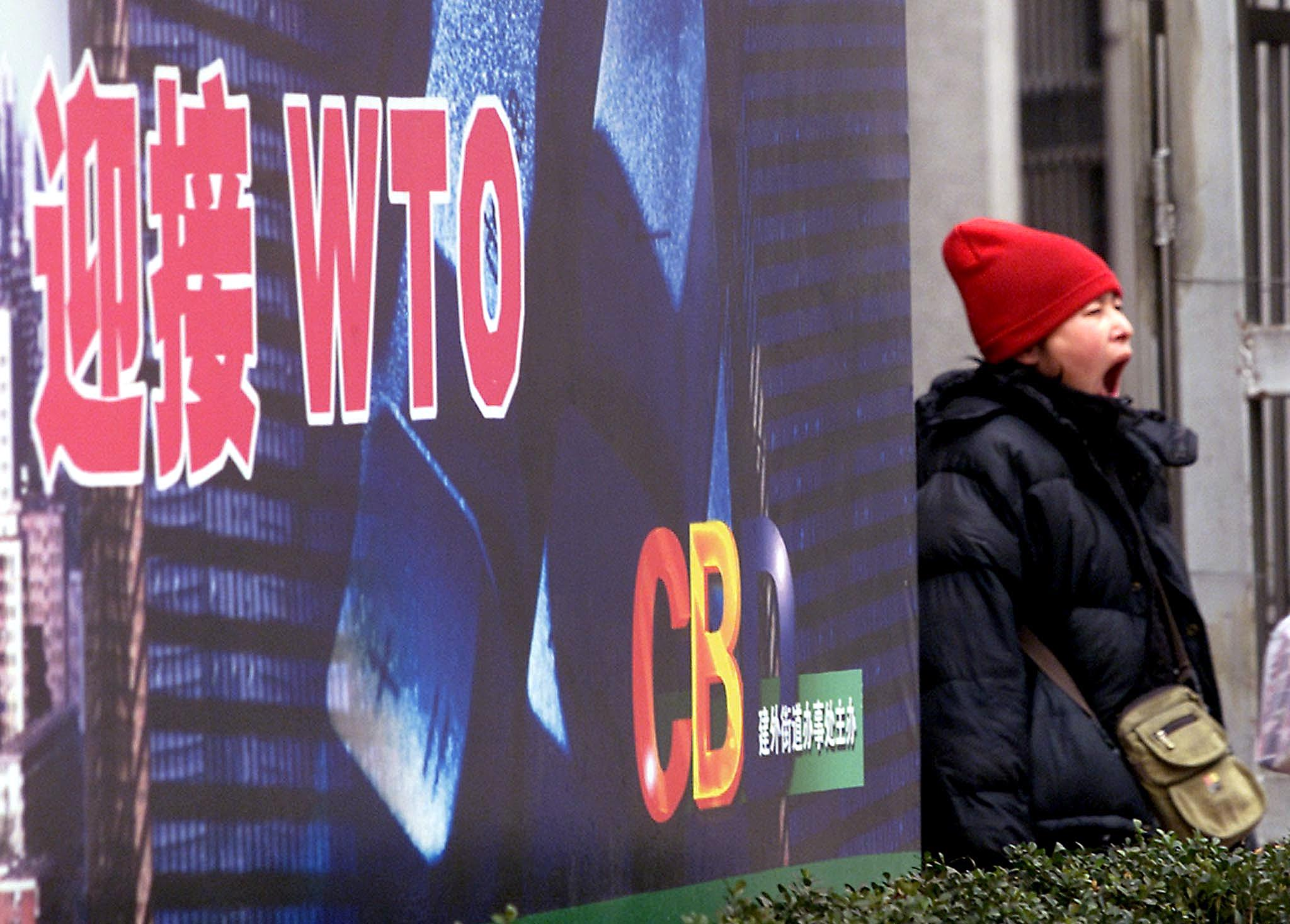 中國大陸出走者證實,中共在1995至2000年期間通過系統性造假,欺騙美國國會通過給予中國最惠國待遇,為中國加入世貿鋪平道路。(GOH CHAI HIN/AFP/Getty Images)