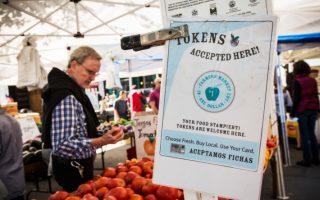 農貿市場險廢糧食券付款