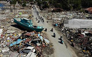 強震中捨身救人 印尼追悼機場調度員阿貢