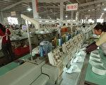 原中國企業主及原中國金融高管,盤點了中共當局在現金流捉襟見肘情況下,如何巧取豪奪、併吞中小企業資產。(China Photos/Getty Images)
