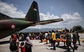 地震和海嘯致240萬人受災 印尼合葬遇難者