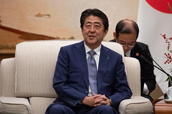 安倍晋三访华。(ROMAN PILIPEY/AFP/Getty Images)